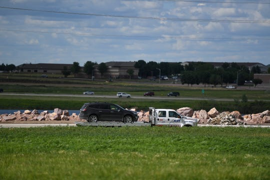 Angela Armstrong's dark grey 2017 Chevy Traverse is towed away from a crime scene on Tuesday, June 23, 2020 in Sioux Falls, S.D.