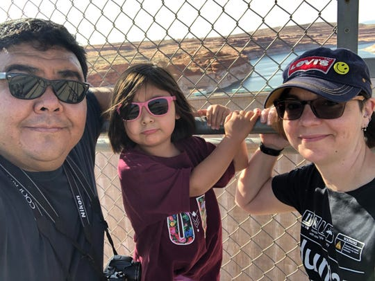 Lindison Webb, left, with his daughter and wife by Glen Canyon, UT.
