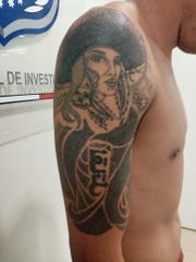 Arm tattoo of Ismael G.H., who is accused of killing six people in a shooting at a home in Juárez, Mexico.