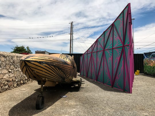 """A plane fuselage being worked on by Laura Turón is next to her work, """"Paradox Pyramid,"""" which is on display at Galeria Lincoln."""