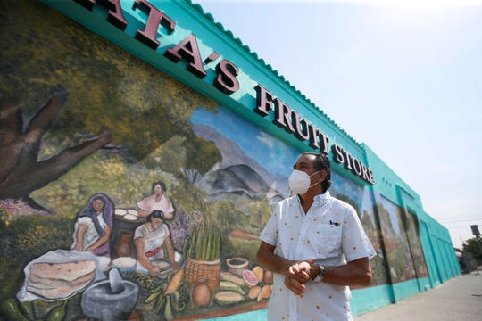 Carlos Jaime Mata, owner of Mata's Fruit Store, talks about his family's store in Segundo Barrio Tuesday, June 23, in El Paso. Mata grew up in Segundo Barrio helping his dad sell groceries at the original store. Mata has bought three additional buildings in the area to expand the grocery store over time.