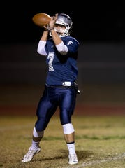 Farmersville quarterback Sam Metcalf (7) drops back to pass during the 2013 season.