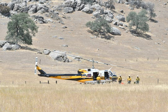 Hundreds of firefighters battle the 600-acre Grade Fire in eastern Tulare County on Monday.