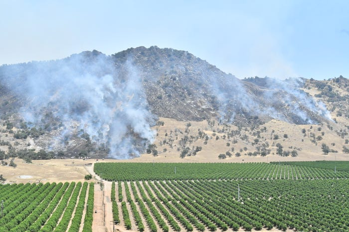 In CA: A surge in COVID-19 cases is breaking records, and wildfires heat up