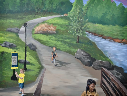 Mural artist Aaron Campbell included several people and small details in her mural of the waterfalls and trail area for the Wichita Falls Chamber of Commerce.