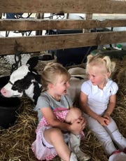 Little children like these two, Carley Ehlke, Kohlsville and Alaya Hafemeister, Hustisford, look forward to county fairs.