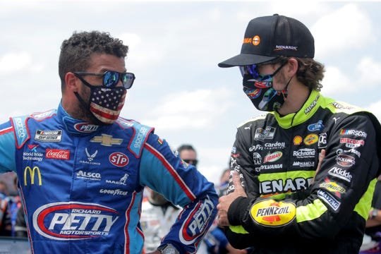 Ryan Blaney stands with close friend Bubba Wallace on the grid at Talladega Superspeedway before Monday's GEICO 500.