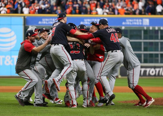 Nationals players celebrate on the field after defeating the Houston Astros in Game 7 of the 2019 World Series.