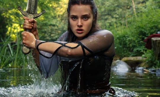 "Katherine Langford as the sword-toting Nimue in ""Cursed."""