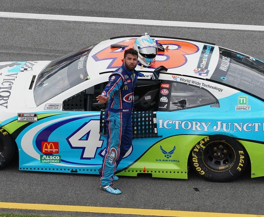 Bubba Wallace waves to fans after competing in Monday's GEICO 500 at Talladega Superspeedway.