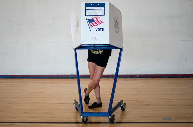 A woman votes at a polling site in Queens during the New York Democratic presidential primary elections on June 23, 2020, in New York City.