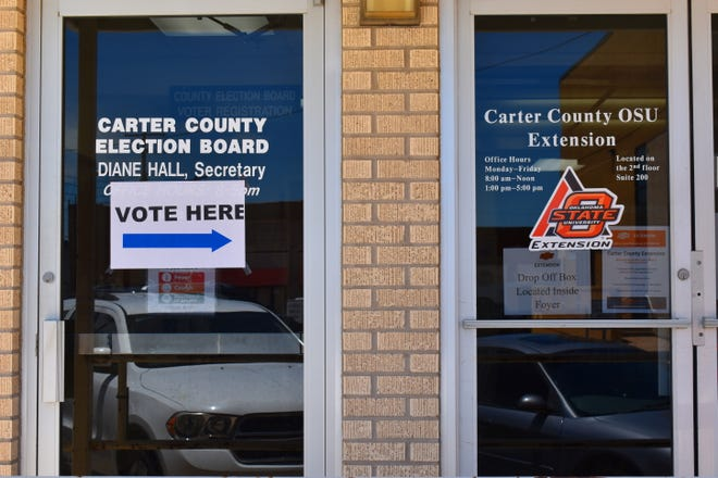 A sign direct early voters to the temporary entrance of election offices for early voting. A county election official said the dedicated entrance will promote social distancing during early voting on Thursday, Friday and Saturday.