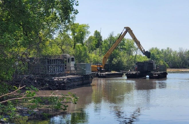 Neenah Foundry is paying to remove contaminated sediment from a section of the Neenah Slough south of Bridgewood Golf Course.