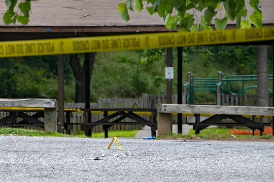 Police tape is wrapped around Walton Street Park and leftover medical equipment is tagged with forensics evidence markers on the ground on June 24, 2020 following a fatal shooting at the Southside neighborhood park the night before. Kevon Tyshawn Ailes, 25, died and two others were injured during the shooting, which was the second reported at the park in two days.