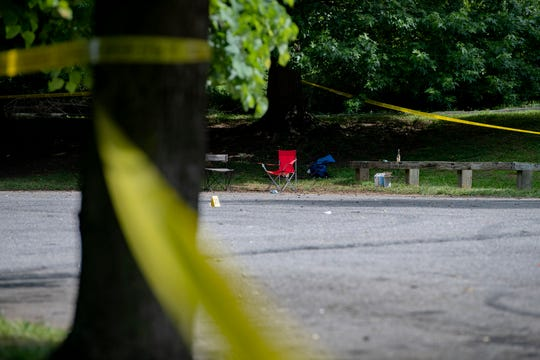 Camping chairs and a beer bottle remain in a police-tape-wrapped Walton Street Park on June 24, 2020 following a fatal shooting the night before. Kevon Tyshawn Ailes, 25, died and two others were injured during the shooting, which was the second reported at the park in two days.