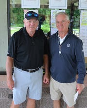 Senior Cal-Am Golf Championship winner Mike Raymond, left, stands with Binder Park Golf Course General Manager Ron Osborne near the leaderboard.