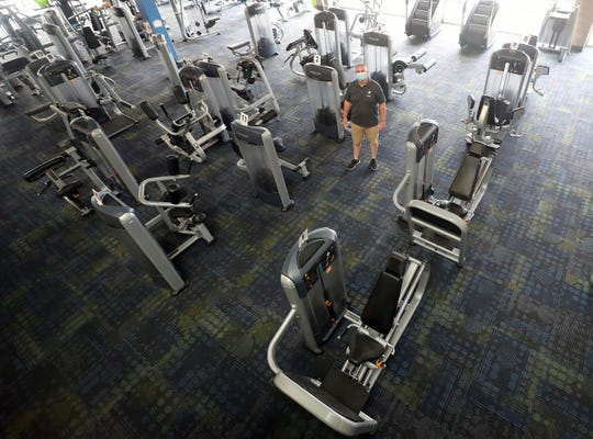 Haselwood Family YMCA executive director Harold Shea stands among the workout equipment that he has been spaced out in anticipation of Kitsap entering into Phase 3 of the governor's coronavirus recovery plan.