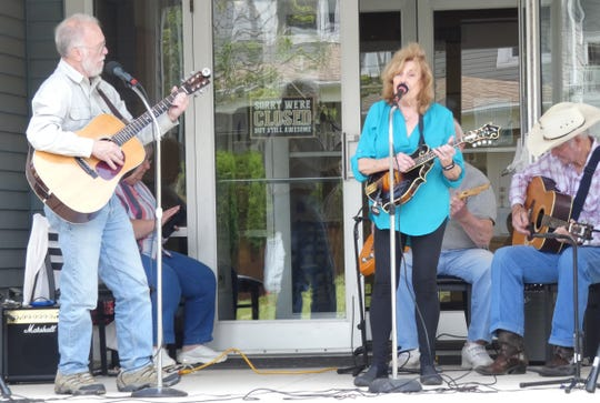 Linda Hamilton sings as Harvey & Friends performs outside the Crawford County Council on Aging on Wednesday.