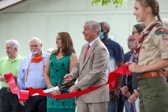 Clarksville Mayor Joe Pitts cuts a ribbon to officially re-open the park and new pavilion area at Billy Dunlop Park in Clarksville, Tenn., on Wednesday, June 24, 2020.