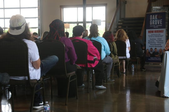 Job candidates wait for their auditions at the job fair for Oak Grove Racing & Gaming, held at Old Glory Distilling Co. on June 23, 2020.