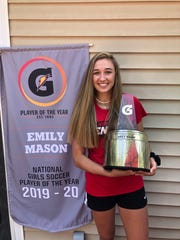 Emily Mason with the Gatorade National Girls Soccer Player of the Year trophy