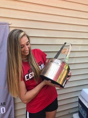 Emily Mason looks at the Gatorade National Girls Soccer Player of the Year trophy