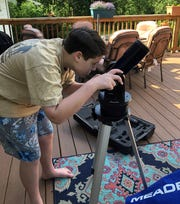 A telescope is a new addition to the Heinsohn's yard.