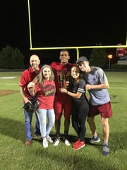 Junior Colson poses for a picture with his family (father Steve, mother Melanie, sister Amanda and brother Josh) after a football game.