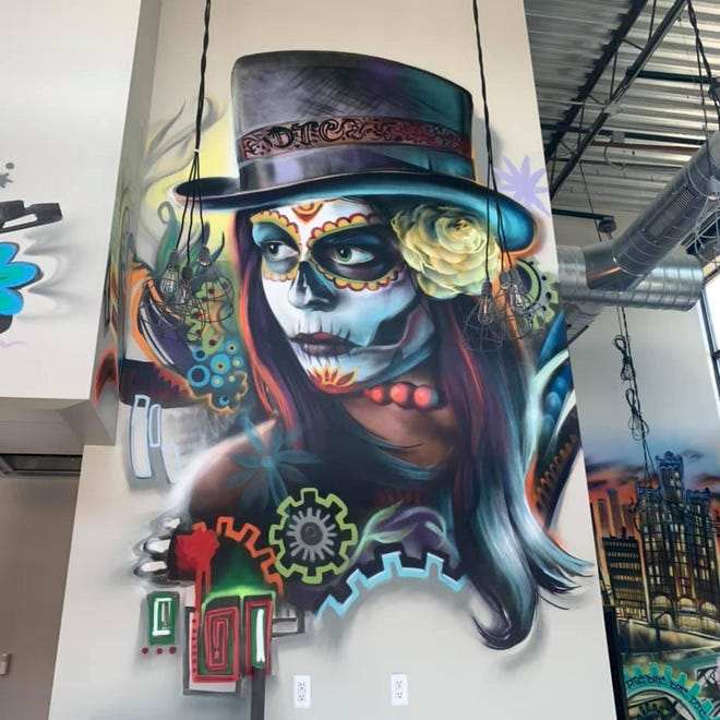 Artist Kevin Burdick's work at the Shelby Township location of Detroit Taco Company.