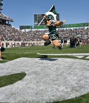 Michigan State athletic director Bill Beekman says he anticipates limited attendance at Spartan Stadium this season.