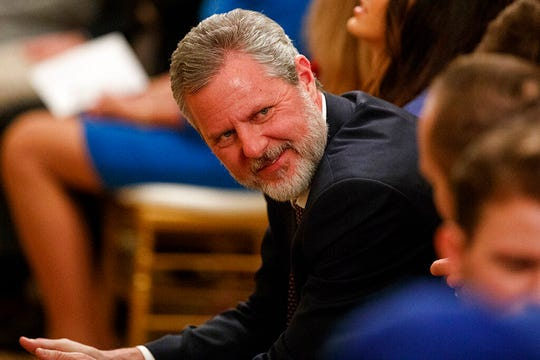 """In this March 21, 2019 file photo, Jerry Falwell Jr., president of Liberty University, waits for the arrival of President Donald Trump to sign an executive order on """"improving free inquiry, transparency, and accountability on campus"""" in the East Room of the White House in Washington."""