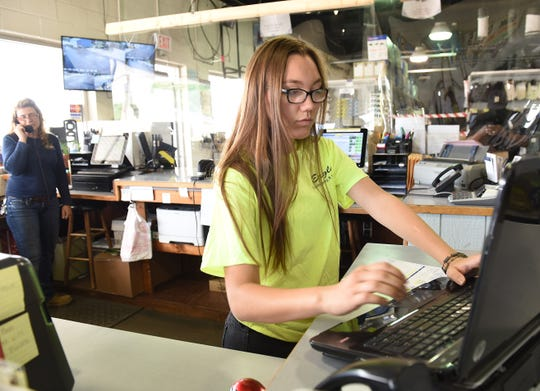 Adrienne Eagle,17, works the cash register at Eagle Supply in Southfield on Wednesday, June 24, 2020.