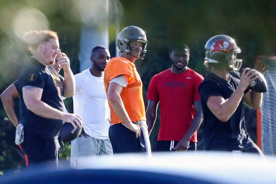 Tom Brady works out with Buccaneers teammates on Tuesday at Berkeley Preparatory School in Tampa, Fla.