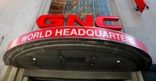 The sign outside the world headquarters of GNC in downtown Pittsburgh is shown in this  July 15, 2019, file photo.