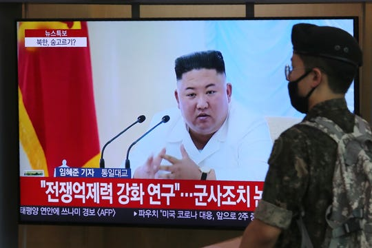 A South Korean army soldier passes by a TV showing a file image of North Korean leader Kim Jong Un during a news program at the Seoul Railway Station in Seoul, South Korea, Wednesday.