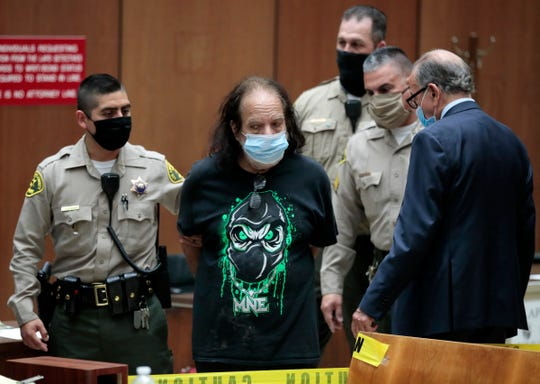 Adult film star Ron Jeremy, second left, with his attorney Stuart Goldfarb, right, makes his first appearance in Dept. 30 at Los Angeles Superior Court in Los Angeles, Tuesday, June 23, 2020.