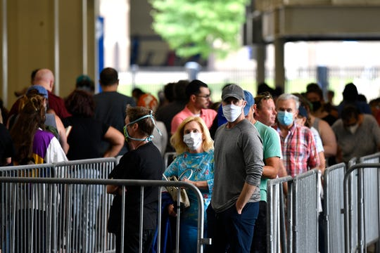 Voters patiently waited in line to cast their ballots in the Kentucky primary at Kroger Field in Lexington, Ky., Tuesday.