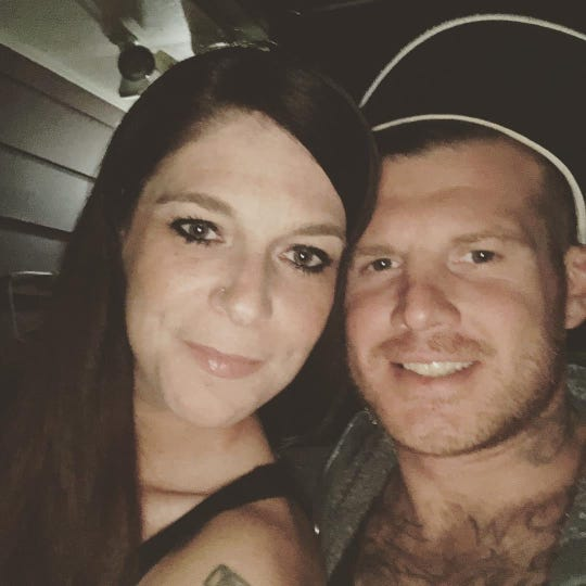 Rachel Litwiller, who works as a server at a Lansing restaurant, pictured with her husband, Zach.