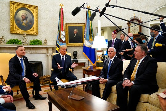 President Donald Trump meets with Polish President Andrzej Duda in the Oval Office of the White House, Wednesday, June 24, 2020, in Washington, as Vice President Mike Pence and Secretary of State Mike Pompeo listen.