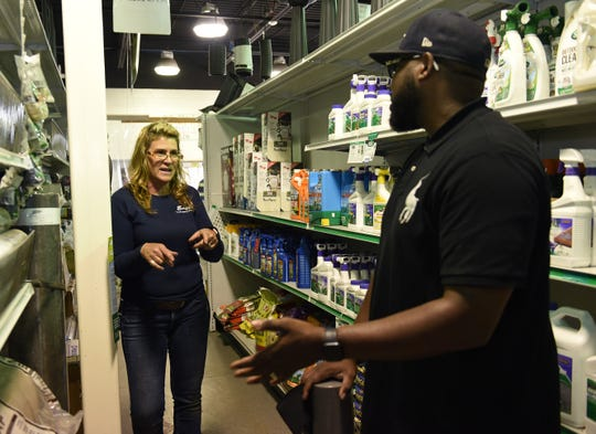 Deborah Eagle helps customer Tim Hibbler with  items to make a playground. Eagle Landscaping & Supply Co. in Southfield has had trouble finding workers this spring.