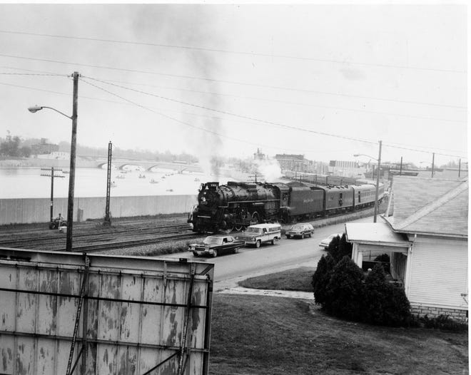 A steam train on North Front Street looking south from the Trestle Bridge.