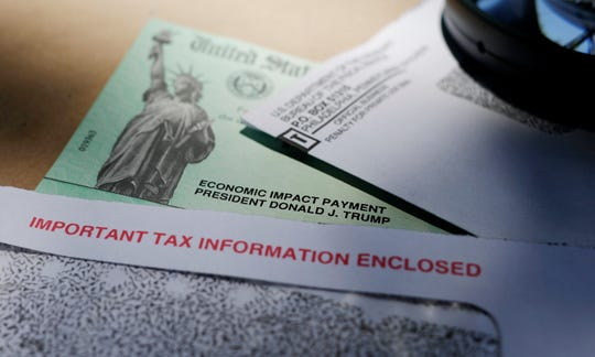 Donald Trump's name is seen on a stimulus check issued by the IRS to help combat the adverse economic effects of the COVID-19 outbreak, in San Antonio.