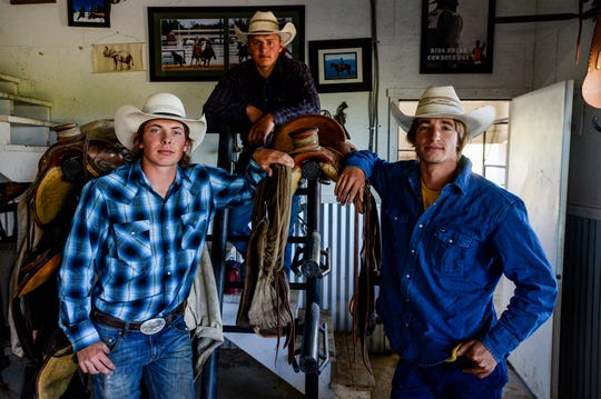Keagan Stroop, left, Troy Hennes, center, and Harry Green, friends from their high school days at Belt High, gather at Green's family home outside of Belt, Mont., on June 24, 2020, to prepare for a 45-day, 500-mile horseback trip through Montana's backcountry to raise money for cancer care and research.