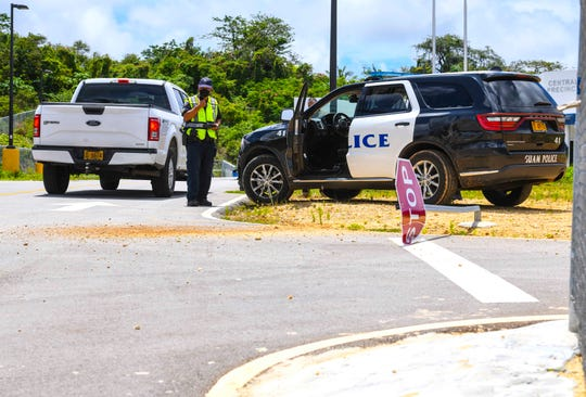 Guam Police Department officers investigate a hit-and-run collision, involving a GPD official vehicle, that occurred at the entrance of its central precinct in Afame, Sinajana on Wednesday, June 24, 2020.  Two officers were injured in the crash, according to Sgt. Paul Tapao, GPD spokesman.