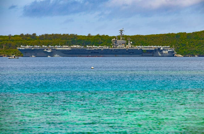 The U.S. Navy's nuclear-powered multi-mission supercarrier, the USS Nimitz, ported at Naval Base Guam in Apra Harbor on Wednesday, June 24, 2020. The USS Nimitz, America's oldest aircraft carrier still in active service, pulled into port earlier in the day.