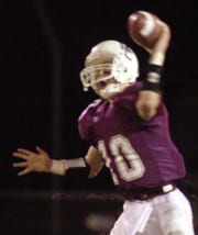 Henderson County quarterback Wes Peckenpaugh fires   a pass during the 2002 regional championship game against Christian County.
