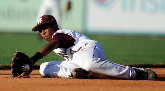 Henderson County shortstop Ethan Meeler makes the stop from the ground to hold the runner at first during the 2012 state tournament against Newport Central Catholic in Lexington.