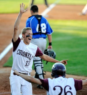Henderson County's Kaleb Duckworth (13) celebrates after crossing home plate to end their 9-inning battle with Newport Central Catholic at the 2012 state baseball tournament in Lexington.