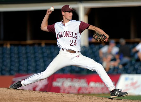 Henderson County's Marty Coursey pitches during the 2012 state tournament against Newport Central Catholic in Lexington.