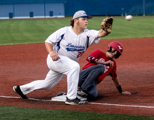 Lancaster Post 11 third baseman Dylan Anthony waits for the ball as a Utica Post 92 player slides in safely during their game Tuesday night at Beavers Field.